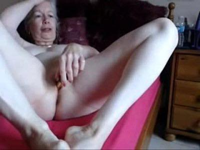 Flirty Granny Stimulates Her Pussy With Sex Toy On Webcam