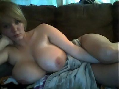 Young Blonde Flaunting Her Huge Natural Boobs